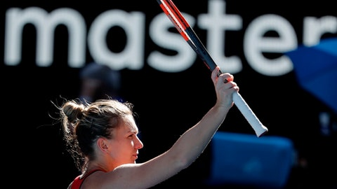 Romania's Simona Halep reacts after defeating Australia's Destanee Aiava during their first round match at the Australian Open tennis championships in Melbourne, Australia, Tuesday, Jan. 16, 2018. (AP Photo/Vincent Thian)