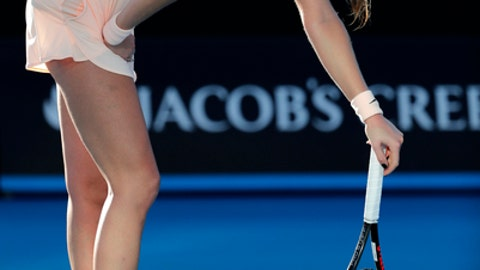 Petra Kvitova of the Czech Republic bends over while playing Germany's Andrea Petkovic during their first round match at the Australian Open tennis championships in Melbourne, Australia, Tuesday, Jan. 16, 2018. (AP Photo/Vincent Thian)