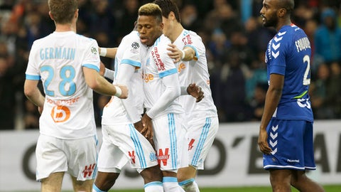 Marseille's players celebrate after Marseille's Clinton Mua Njie, center, scored during the League One soccer match between Marseille and Strasbourg, at the Velodrome stadium, in Marseille, southern France, Tuesday, Jan. 16, 2018. (AP Photo/Claude Paris)