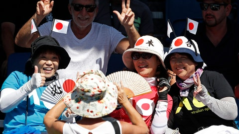 Fans pose for a photo ahead of the second round match between Japan's Yoshihito Nishioka and Italy's Andreas Seppi at the Australian Open tennis championships in Melbourne, Australia, Wednesday, Jan. 17, 2018. (AP Photo/Ng Han Guan)