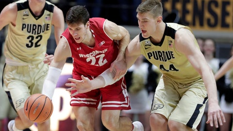 Purdue center Isaac Haas (44) and Wisconsin forward Ethan Happ (22) go after a loose ball in the first half of an NCAA college basketball game in West Lafayette, Ind., Tuesday, Jan. 16, 2018. (AP Photo/Michael Conroy)
