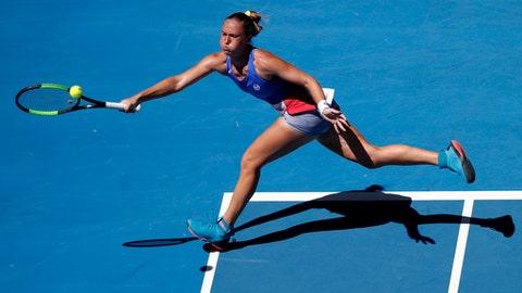 Ukraine's Kateryna Bondarenko reaches for a return to Russia's Anastasia Pavlyuchenkova during their second round match at the Australian Open tennis championships in Melbourne, Australia, Wednesday, Jan. 17, 2018. (AP Photo/Vincent Thian)