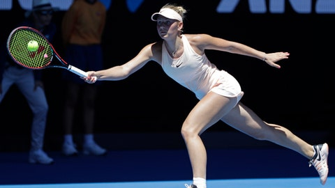 Ukraine's Marta Kostyuk reaches for a forehand return to Australia's Olivia Rogowska during their second round match at the Australian Open tennis championships in Melbourne, Australia, Wednesday, Jan. 17, 2018. (AP Photo/Dita Alangkara)