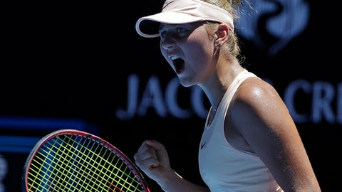 Ukraine's Marta Kostyuk celebrates a point win over Australia's Olivia Rogowska during their second round match at the Australian Open tennis championships in Melbourne, Australia, Wednesday, Jan. 17, 2018. (AP Photo/Dita Alangkara)