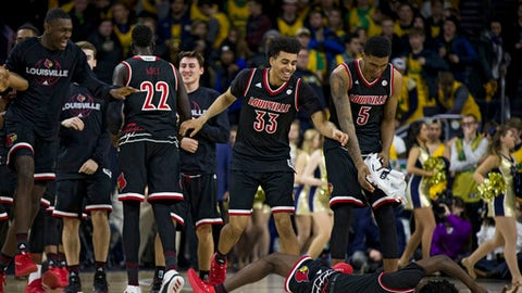 Louisville players celebrate following their 82-78 win over Notre Dame in an NCAA college basketball game Tuesday, Jan. 16, 2018, in South Bend, Ind. (AP Photo/Robert Franklin)
