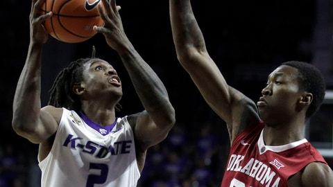 Kansas State guard Cartier Diarra (2) shoots over Oklahoma forward Kristian Doolittle (21) during the second half of an NCAA college basketball game in Manhattan, Kan., Tuesday, Jan. 16, 2018. (AP Photo/Orlin Wagner)