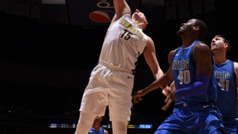 DENVER, CO - JANUARY 16 : Nikola Jokic #15 of the Denver Nuggets drives to the basket during the game against the Dallas Mavericks on January 16, 2018 at the Pepsi Center in Denver, Colorado. NOTE TO USER: User expressly acknowledges and agrees that, by downloading and/or using this photograph, user is consenting to the terms and conditions of the Getty Images License Agreement. Mandatory Copyright Notice: Copyright 2018 NBAE (Photo by Garrett Ellwood/NBAE via Getty Images)