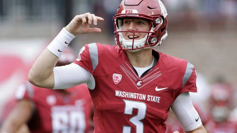 FILE - In this Sept. 17, 2016 file photo, Washington State quarterback Tyler Hilinski (3) runs onto the field with his teammates before an NCAA college football game against Idaho in Pullman, Wash. Hilinski has died from an apparent self-inflicted gunshot wound. The 21-year-old Hilinski was discovered in his apartment after he didn't show up for practice Tuesday, Jan. 16, 2018. (AP Photo/Young Kwak, File)