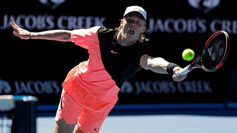 Canada's Denis Shapovalov stretches out for a return shot to France's Jo-Wilfried Tsonga during their second round match at the Australian Open tennis championships in Melbourne, Australia, Wednesday, Jan. 17, 2018. (AP Photo/Dita Alangkara)