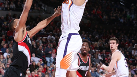 PORTLAND, OR - JANUARY 16:  Devin Booker #1 of the Phoenix Suns shoots the ball against the Portland Trail Blazers on January 16, 2018 at the Moda Center in Portland, Oregon. NOTE TO USER: User expressly acknowledges and agrees that, by downloading and or using this Photograph, user is consenting to the terms and conditions of the Getty Images License Agreement. Mandatory Copyright Notice: Copyright 2018 NBAE (Photo by Sam Forencich/NBAE via Getty Images)