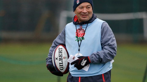 FILE - In this Tuesday, Feb. 14, 2017 file photo, England's head coach Eddie Jones smiles during an England rugby union team training session at a school in London. England coach Eddie Jones has agreed to a two-year contract extension that will keep him in one of rugby's most high-profile jobs until 2021. (AP Photo/Alastair Grant, File)