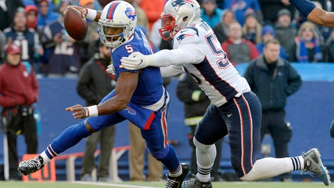 FILE- In this Dec. 3, 2017, file photo, Buffalo Bills quarterback Tyrod Taylor (5) is sacked by New England Patriots outside linebacker Kyle Van Noy (53) during the second half of an NFL football game in Orchard Park, N.Y. After being traded to New England early last season, Van Noy's contributed sparingly during the Patriots' Super Bowl run. But this season he's been thrust into a leadership role following Dont'a Hightower's season-ending injury. It's made Van Noy just the latest example of a previously unknown player that has flourished with the Patriots. (AP Photo/Adrian Kraus, File)