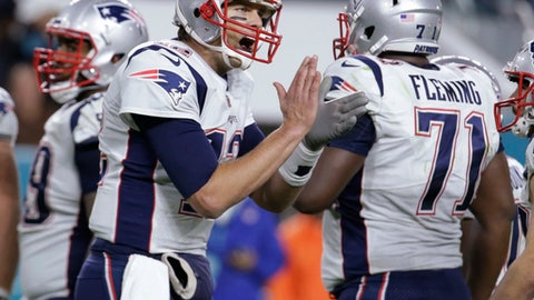FILE - In this Dec. 11, 2017, file photo, New England Patriots quarterback Tom Brady (12) cheers the offensive line during the second half of an NFL football game against the Miami Dolphins in Miami Gardens, Fla. The New England Patriots host the Jacksonville Jaguars in the AFC championship on Sunday.  (AP Photo/Lynne Sladky, File)