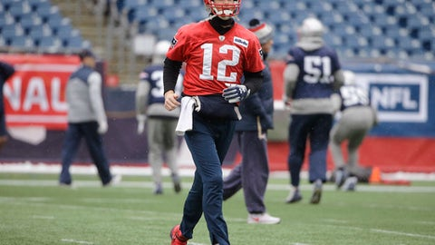 New England Patriots quarterback Tom Brady (12) warms up during NFL football practice, Wednesday, Jan. 17, 2018, at Gillette Stadium, in Foxborough, Mass. (AP Photo/Steven Senne)