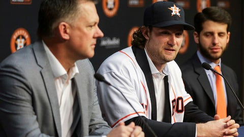 Houston Astros newly acquired pitcher Gerrit Cole, center, speaks at a press conference after being introduced at Minute Maid Park Wednesday, Jan. 17, 2018 in Houston. (Michael Ciaglo/Houston Chronicle via AP)