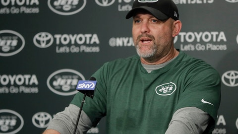 FILE - In this Tuesday, May 23, 2017 file photo, New York Jets offensive coordinator John Morton talks to reporters during the team's organized team activities at its NFL football training facility in Florham Park, N.J. A person with direct knowledge of the decision says the New York Jets have fired offensive coordinator John Morton after one season. The person spoke to The Associated Press on Wednesday, Jan. 17, 2018 on condition of anonymity because the team had not announced the move.(AP Photo/Julio Cortez, File)