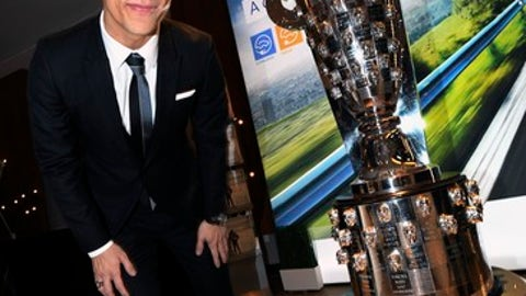 Indy 500 winner Takuma Sato poses with the Borg Warner Trophy at the Automotive News World Congress at the GM Ren Cen in Detroit, Wednesday,  Jan. 17, 2018. (Daniel Mears/Detroit News via AP)
