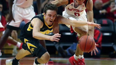 Iowa' Nicholas Baer, left, and Rutgers' Geo Baker (0) battle for a loose ball during an NCAA college basketball game, Wednesday, Jan. 17, 2018 in Piscataway, N.J. (John Munson/NJ Advance Media via AP)