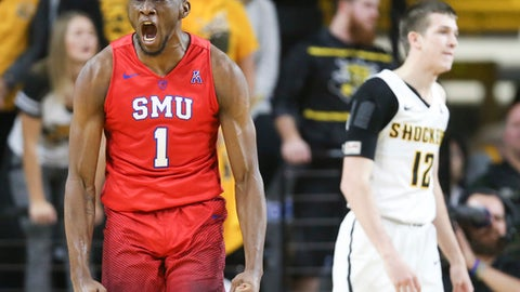 SMU guard Shake Milton celebrates a shot and a foul while Wichita State guard Austin Reaves can only watch during the second half of an NCAA college basketball game, Wednesday, Jan. 17, 2018 in Wichita, Kan. (Travis Heying/The Wichita Eagle via AP)