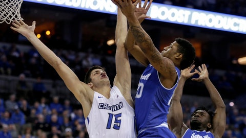 Seton Hall's Desi Rodriguez (20) goes to the basket between Creighton's Martin Krampelj (15) and Michael Nzei (1) during the first half of an NCAA college basketball game in Omaha, Neb., Wednesday, Jan. 17, 2018. (AP Photo/Nati Harnik)