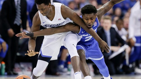 Creighton's Kaleb Joseph (14) and Seton Hall's Jordan Walker (2) chase a loose ball during the first half of an NCAA college basketball game in Omaha, Neb., Wednesday, Jan. 17, 2018. (AP Photo/Nati Harnik)