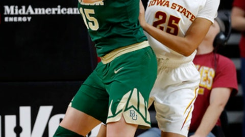 Baylor forward Lauren Cox grabs a rebound in front of Iowa State center Kristin Scott (25) during the first half of an NCAA college basketball game, Wednesday, Jan. 17, 2018, in Ames, Iowa. (AP Photo/Charlie Neibergall)
