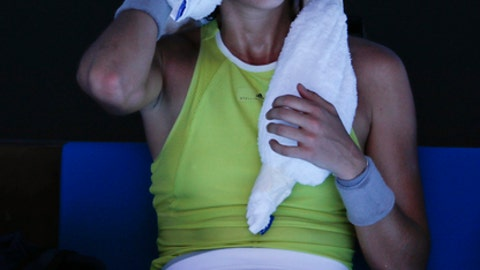 Spain's Garbine Muguruza uses a cool towel during a break while playing Taiwan's Hsieh Su-wei during their second round match at the Australian Open tennis championships in Melbourne, Australia, Thursday, Jan. 18, 2018. (AP Photo/Vincent Thian)