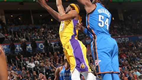 OKLAHOMA CITY, OK - JANUARY 17: Corey Brewer #3 of the Los Angeles Lakers drives to the basket during the game against the Oklahoma City Thunder on January 17, 2018 at Chesapeake Energy Arena in Oklahoma City, Oklahoma. NOTE TO USER: User expressly acknowledges and agrees that, by downloading and or using this photograph, User is consenting to the terms and conditions of the Getty Images License Agreement. Mandatory Copyright Notice: Copyright 2018 NBAE (Photo by Layne Murdoch/NBAE via Getty Images)