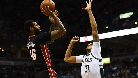 MILWAUKEE, WI - JANUARY 17:  James Johnson #16 of the Miami Heat shoots over John Henson #31 of the Milwaukee Bucks during the second half of a game at the Bradley Center on January 17, 2018 in Milwaukee, Wisconsin.  NOTE TO USER: User expressly acknowledges and agrees that, by downloading and or using this photograph, User is consenting to the terms and conditions of the Getty Images License Agreement.  (Photo by Stacy Revere/Getty Images)