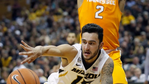 Missouri's Jordan Geist passes the ball as Tennessee's Grant Williams (2) watches during the second half of an NCAA college basketball game Wednesday, Jan. 17, 2018, in Columbia, Mo. Missouri won 59-55. (AP Photo/Jeff Roberson)