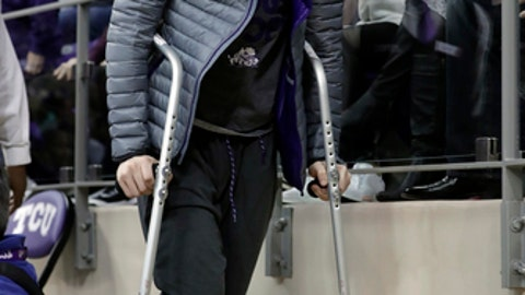 TCU guard Jaylen Fisher leaves the court at the end of a basketball game against Iowa State on Wednesday, Jan. 17, 2018, in Fort Worth, Texas. Fisher could miss the rest of the season for No. 24 TCU after injuring his right knee. It is the second time in about six months he hurt a knee in practice. (AP Photo/Tony Gutierrez)