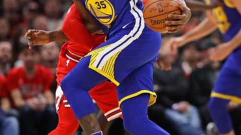 CHICAGO, IL - JANUARY 17:   Kevin Durant #35 of the Golden State Warriors is fouled while driving be David Nwaba #11 of the Chicago Bulls at the United Center on January 17, 2018 in Chicago, Illinois. The Warriors defeated the Bulls 119-112. NOTE TO USER: User expressly acknowledges and agrees that, by downloading and or using this photograph, User is consenting to the terms and conditions of the Getty Images License Agreement. (Photo by Jonathan Daniel/Getty Images)