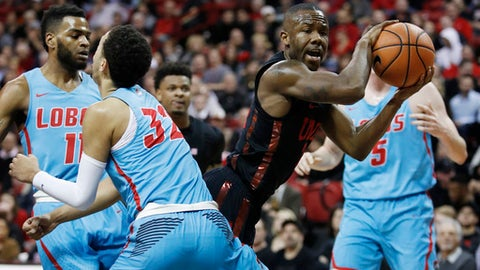 UNLV's Jordan Johnson drives around New Mexico's Anthony Mathis during the second half of an NCAA college basketball game Wednesday, Jan. 17, 2018, in Las Vegas. (AP Photo/John Locher)