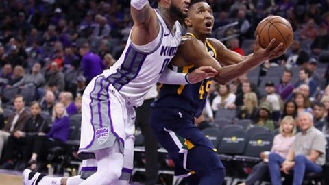 SACRAMENTO, CA - JANUARY 17:  Donovan Mitchell #45 of the Utah Jazz goes up for a shot against Willie Cauley-Stein #00 of the Sacramento Kings at Golden 1 Center on January 17, 2018 in Sacramento, California. NOTE TO USER: User expressly acknowledges and agrees that, by downloading and or using this photograph, User is consenting to the terms and conditions of the Getty Images License Agreement.  (Photo by Ezra Shaw/Getty Images)