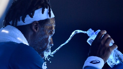 France's Gael Monfils showers himself with water during his second round match against Serbia's Novak Djokovic at the Australian Open tennis championships in Melbourne, Australia, Thursday, Jan. 18, 2018. (AP Photo/Andy Brownbill)