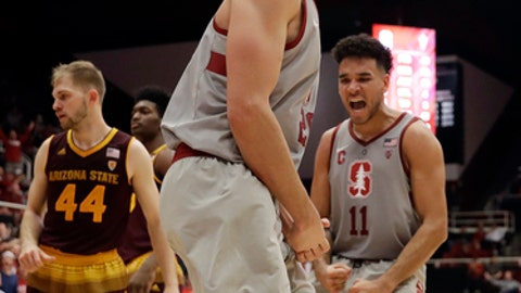 Stanford center Josh Sharma, center, celebrates after dunking against Arizona State during the second half of an NCAA college basketball game Wednesday, Jan. 17, 2018, in Stanford, Calif. (AP Photo/Marcio Jose Sanchez)