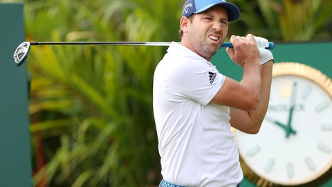 In this Wednesday, Jan. 17, 2018, photo, Spain's Sergio Garcia practices for the Singapore Open golf tournament in Singapore. Garcia kicked off his 2018 season in style on Thursday, Jan. 18, 2018, shooting a 5-under 66 to take a two-stroke lead after the first round of the Singapore Open. (Kyodo News via AP)