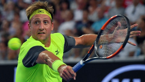United States' Tennys Sandgren hits a backhand return to Switzerland's Stan Wawrinka during their second round match at the Australian Open tennis championships in Melbourne, Australia, Thursday, Jan. 18, 2018. (AP Photo/Andy Brownbill)