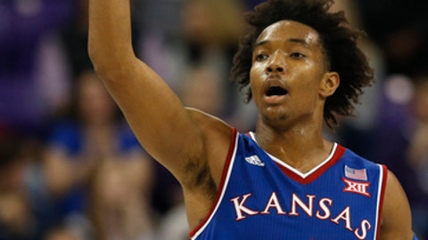 "FILE - In this Jan. 6, 2018, file photo, Kansas guard Devonte' Graham (4) reacts after sinking a three-point shot against TCU during the second half of an NCAA college basketball game, in Fort Worth, Texas. The hallmarks of Kansas under Bill Self have been inside-outside post play and gritty defense. Three-pointers were ""fool's gold"" and out-running teams was the stuff of Roy Williams. Well, look who is relying on 3-pointers and piling up points these days. (AP Photo/Ron Jenkins, File)"