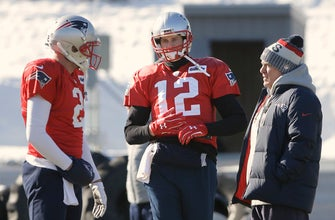 Images of Patriots' Brady misses practice with right hand injury