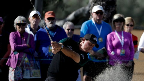 Phil Mickelson hits form the bunker on the sixth hole during first round of the CareerBuilder Challenge golf tournament at La Quinta Country Club Thursday, Jan. 18, 2018, in La Quinta, Calif. (AP Photo/Chris Carlson)