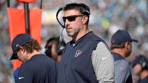 FILE - In this Dec. 17, 2017, file photo, Houston Texans defensive coordinator Mike Vrabel watches from the sideline during the first half of an NFL football game against the Jacksonville Jaguars, in Jacksonville, Fla. The Tennessee Titans have finished interviewing Houston defensive coordinator Mike Vrabel, the first candidate for their head coach opening. The Titans announced they concluded the interview early Thursday afternoon, Jan. 18, 2018. Tennessee is looking to replace Mike Mularkey, fired Monday after he went 21-22 and won the franchise's first playoff game in 14 years. Vrabel is coming off his first season as defensive coordinator for the Texans. (AP Photo/Phelan M. Ebenhack, File)