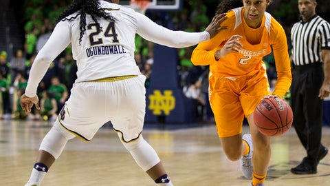 Tennessee's Evina Westbrook (2) is pressured by Notre Dame's Arike Ogunbowale (24) during the first half of an NCAA college basketball game Thursday, Jan. 18, 2018, in South Bend, Ind. (AP Photo/Robert Franklin)