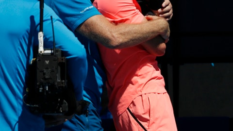 Britain's Kyle Edmund receives treatment from a trainer during third round match against Georgia's Nikoloz Basilashvili at the Australian Open tennis championships in Melbourne, Australia, Friday, Jan. 19, 2018. (AP Photo/Ng Han Guan)