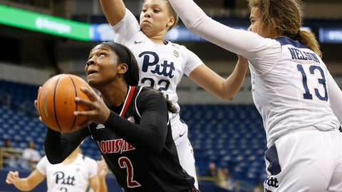 Louisville forward Myisha Hines-Allen (2) goes for a layup in front of Pittsburgh guard Kyla Nelson (13) during the first half of an NCAA college basketball game, Thursday, Jan. 18, 2018, in Pittsburgh. (AP Photo/Jared Wickerham)
