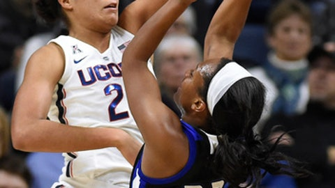 Connecticut's Napheesa Collier, left, blocks a shot attempt by Tulsa's Morgan Brady, right, during the first half an NCAA college basketball game Thursday, Jan. 18, 2018, in Storrs, Conn. (AP Photo/Jessica Hill)