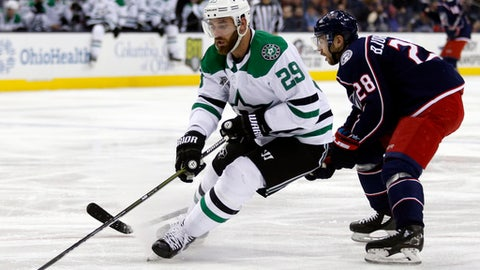 Dallas Stars defenseman Greg Pateryn, left, controls the puck against Columbus Blue Jackets forward Oliver Bjorkstrand, of Denmark, during the second period of an NHL hockey game in Columbus, Ohio, Thursday, Jan. 18, 2018. (AP Photo/Paul Vernon)