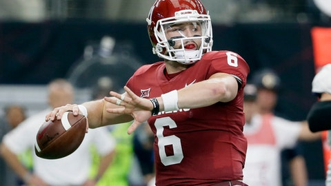 "FILE - In this Dec. 2, 2017, file photo, Oklahoma quarterback Baker Mayfield throws a pass during the first half of the Big 12 Conference championship NCAA college football game against TCU in Arlington, Texas. Mayfield says one of his top priorities as he prepares for the NFL draft is to allay concerns about his character. ""People will have their guesses and their opinions on my character, but anyone that's actually sat down and talked to me knows that I don't have any character issues, any off-the-field issues,"" Mayfield said Thursday evening, Jan. 18, during a conference call after named the 2017 Manning Award winner. (AP Photo/Tony Gutierrez, File)"