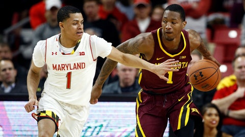 Minnesota guard Dupree McBrayer, right, drives past Maryland guard Anthony Cowan during the first half of an NCAA college basketball game in College Park, Md., Thursday, Jan. 18, 2018. (AP Photo/Patrick Semansky)