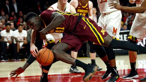 Minnesota forward Gaston Diedhiou (41) falls to the court as he tries to maintain possession during the first half of the team's NCAA college basketball game against Maryland in College Park, Md., Thursday, Jan. 18, 2018. (AP Photo/Patrick Semansky)